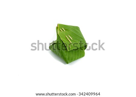 Sticky rice wrapped in banana leaves