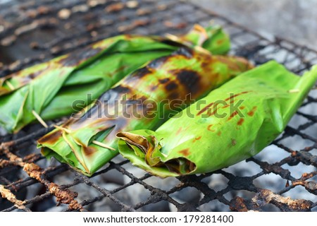 Sticky rice wrapped in banana leaves grill