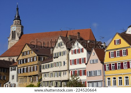 Stiftskirche and Traditional buildings in the city of Tuebingen, Germany - stock photo