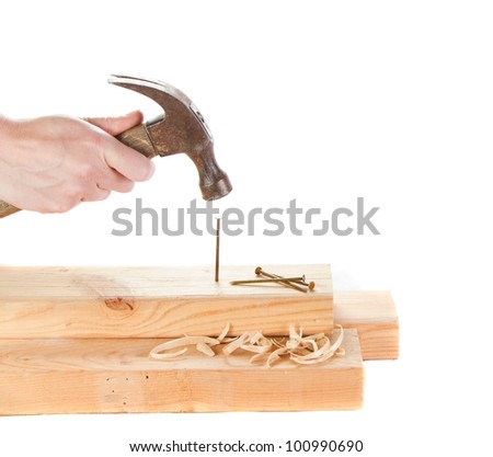 Stiking a nail with a hammer isolated on white backgroun - stock photo