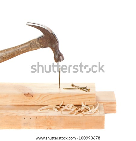 Stiking a nail with a hammer isolated on white background - stock photo