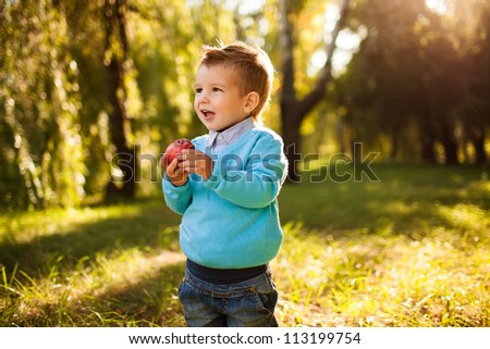 stilish baby boy having fun outside in the park,laughing - stock photo