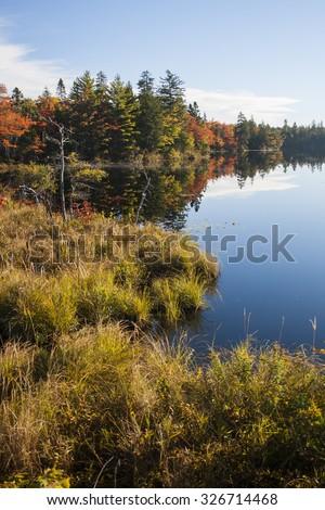 Still Autumn Lake in Nova Scotia, Canada. - stock photo