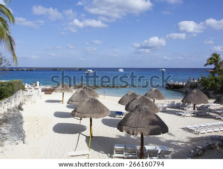 Still empty beach in the morning on Cozumel island (Mexico). - stock photo