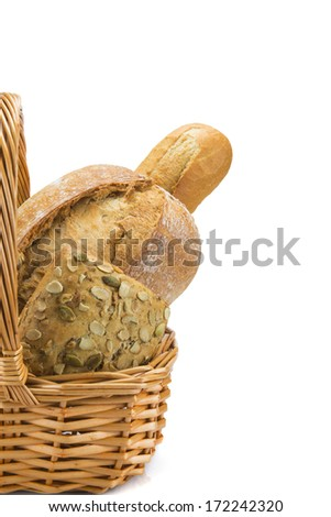 Still life about a basket with a large bread assortment isolated over a white background