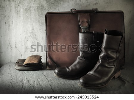 Still life art on casual concept with boots wallet purse case