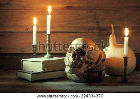 Still life art photography with skull and bowl and books