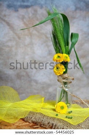 Still-life - bouquet with yellow flowers in phial - stock photo