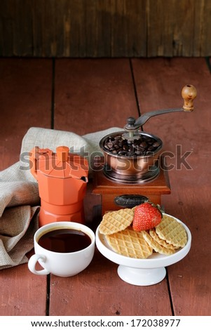 still life breakfast with waffles, strawberries and a cup of coffee