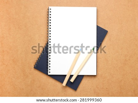 Still life, business, education concept. Office supplies, notepad and pencils on a table. Selective focus, copy space background, top view - stock photo