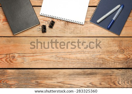 Still life, business, education concept. Office supplies, notepad, diary, staple and pens on a wooden table. Selective focus, copy space background, top view - stock photo