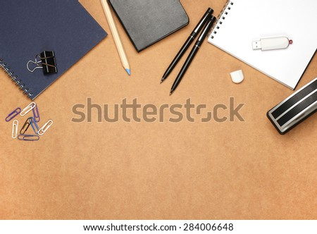 Still life, business, education concept. Office supplies, notepad, diary, stapler, USB flash drive, pencil and pens on a table. Selective focus, copy space background, top view - stock photo