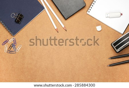 Still life, business, education concept. Office supplies, notepad, diary, stapler, USB flash drive and pencils on a table. Selective focus, copy space background, top view - stock photo