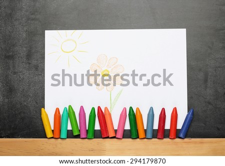 Still life, business, education concept. Painted flower and sun with crayons on a dusty chalkboard. Selective focus, copy space background - stock photo