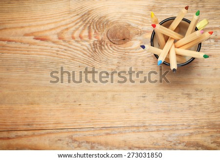 Still life, business, education concept. Pencils in a mug on a wooden table. Selective focus, copy space background, top view - stock photo