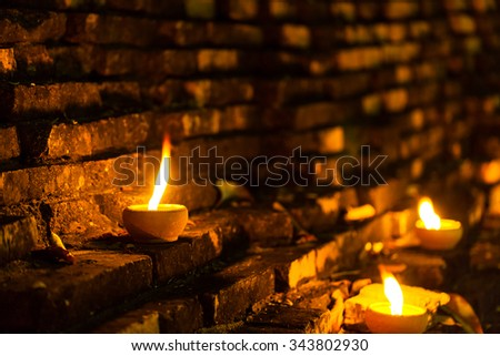 Still life candle light on old wall wiht Loy Krathong festival. - stock photo