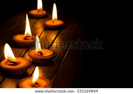 still life candle light on wood plate - stock photo