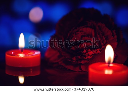still life candle with flower over blurred bokeh background,abstract background for love and valentine concept.