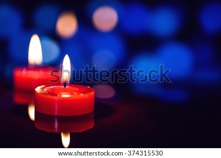 still life candle with reflection over night light bokeh background.
