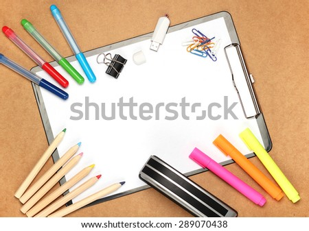 Still life, children, school, education concept.Stationery, clips, USB flash drive, stapler, markers and pencils on a table. Selective focus, copy space background, top view