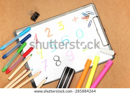 Still life, children, school, education concept. Stationery, clips, USB flash drive, stapler,  pens, markers and pencils on a table. Selective focus, copy space background, top view - stock photo