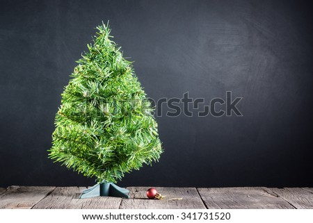 Still life : Christmas tree without any decorations and red decorate ball on old wood with space of art dark background - stock photo