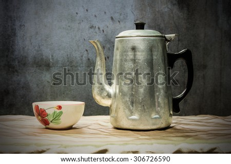 still life classic kettle with cup - stock photo