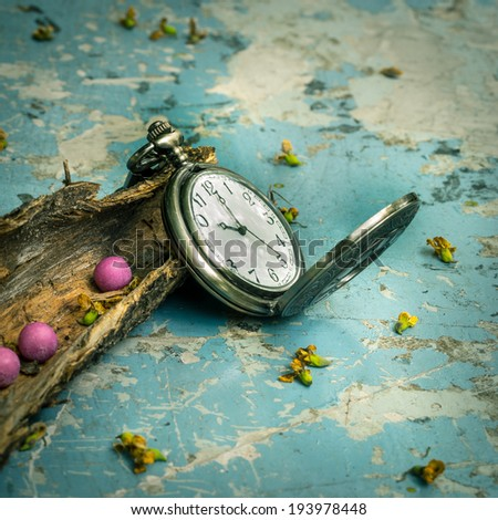 Still life, classic vintage pocket watch  with wood back on grunge metal table background - stock photo