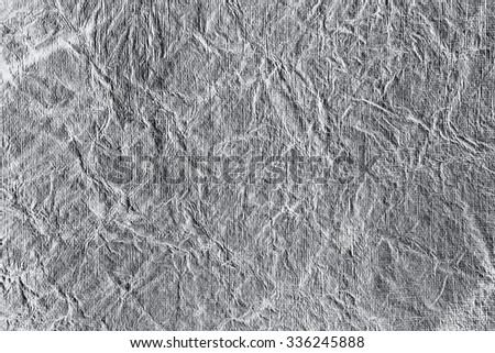 Still life close up detail of a black and white rough grungy and wrinkled piece of paper with lines and texture. Gray full frame background wrinkles textured detail. Monotone colorless blank page. - stock photo