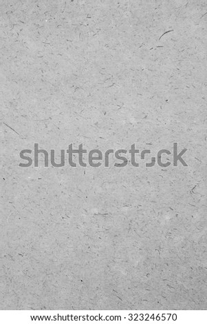 Still life close up detail of a rough splashed piece of writing paper with texture. Plain full frame background noise textured detail in a black and white colorless monotone neutral blank page. - stock photo