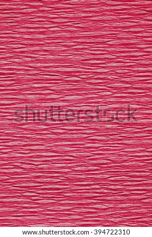 Still life close up detail of a wrinkly bright red rough grungy piece of paper with horizontal lines and thick texture. Magenta full frame background. Vivid monotone color backdrop blank page. - stock photo