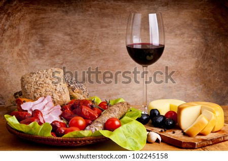 still life composition with traditional food and wine - stock photo