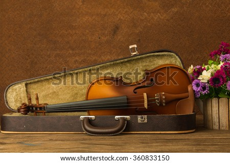 Still life concept, Violin and flowers on wooden table