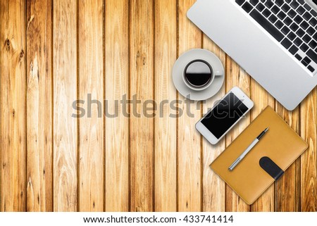 Still life details of laptop and smart phone empty screen material office desktop on wooden desk top view. - stock photo