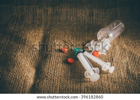 Still life drugs syringe and Methamphetamine also known as crystal meth. - stock photo