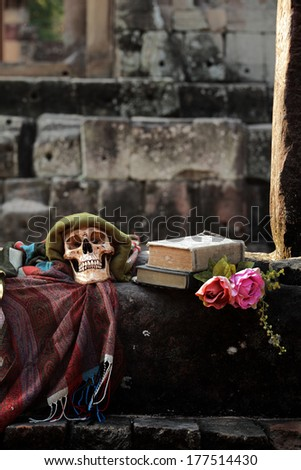 Still life fine art concept on death at ancient stone city