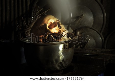 Still life fine art photography on boiled human skull in dirty kitchen - stock photo