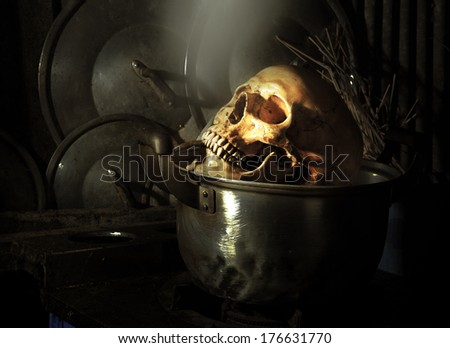 Still life fine art photography on boiled human skull in dirty kitchen