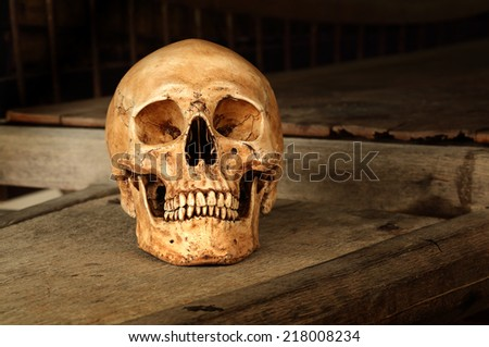 Still life fine art photography on human skeleton criminal concept on old wood cart - stock photo