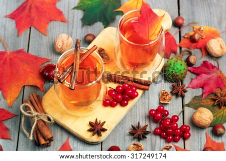 Still life, food and drink, seasonal and holidays concept. Autumn hot beverage in a glass with fruits and spices on a wooden background. Selective focus, top view - stock photo