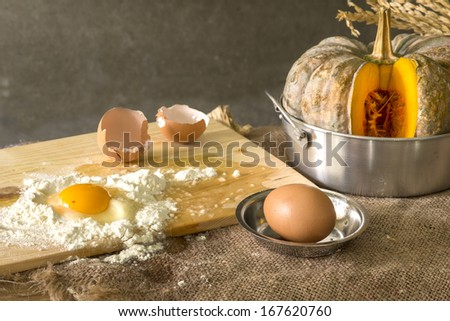 still life food, making a cake with eggs ,pumpkin - stock photo