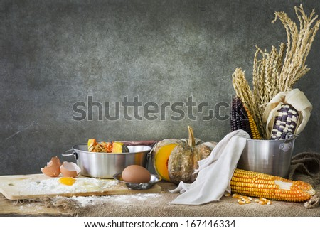 still life food, making a cake with pumpkin,corn and grain - stock photo
