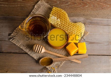 Still life from cup of tea, honey, wax and  honeycombs on wooden table. studio photo top view - stock photo