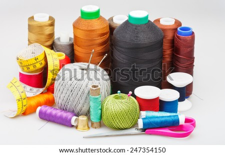 still life from sewing objects on gray background - stock photo