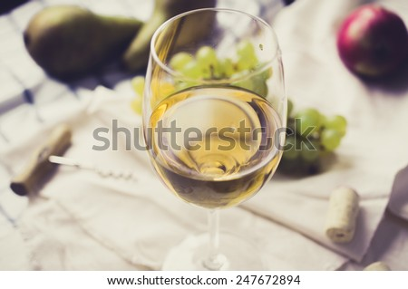 Still life: glass of white wine and grapes - stock photo