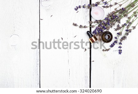 Still life, health and beauty, spa concept. Dry lavender and oil  on a white wooden table. Selective focus, copy space background, top view - stock photo