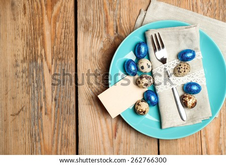 Still life, holidays, food and drink concept. Easter spring decoration with quail and chocolate eggs. Selective focus, top view, copy space background - stock photo