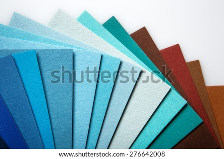 Still life image of a color swatch book shot in the studio on a white background - stock photo