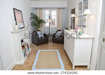 Still life interior home reading room with comfortable quality leather armchairs and fireplace in a stylish house. Aspirational and relaxing home room with sofas and window, indoors living lifestyle. - stock photo