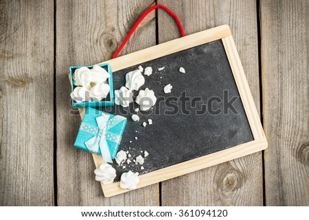 Still life, love and holidays concept. Love and Valentine Day decoration with frame and gift box. Selective focus, copy space rustic wooden background, top view - stock photo